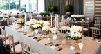 Features Limewash Tiffany Chairs, White Goblets and Antique Candelabra